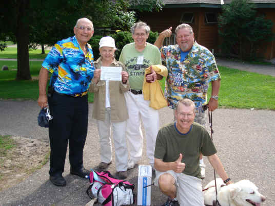 Bill, K9BV; Lucy, KE6QNX, Dr. Dave, KN0S, Bill, N6HBO & Guide Dog Heldy, and Pat, WA0TDA (kneeling in front.) Thumbs up for a pass for Lucy at the VE session.